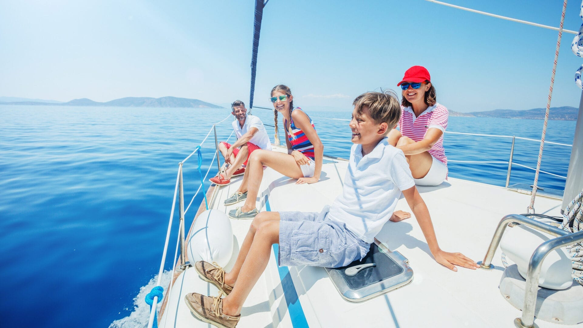 Smiling family on a sailboat