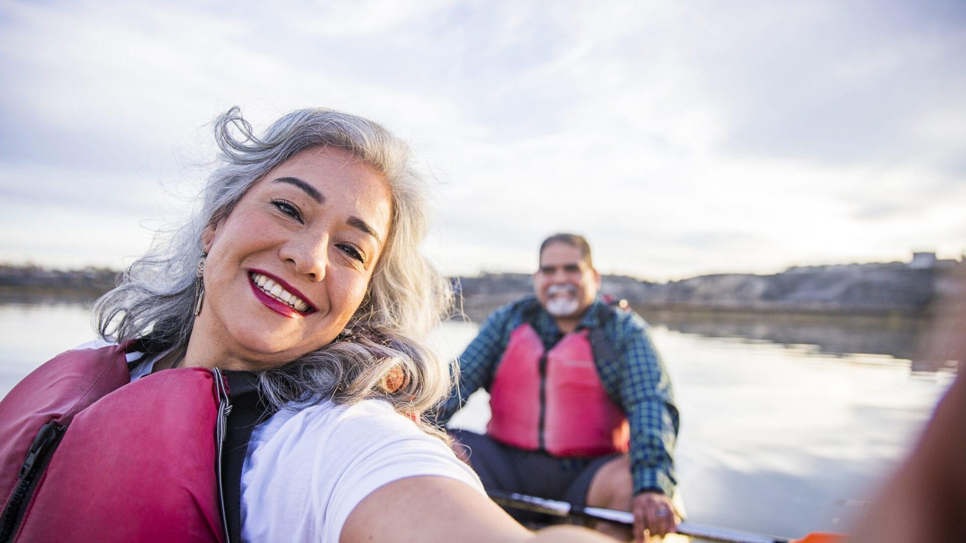 Happy couple enjoying a canoe ride
