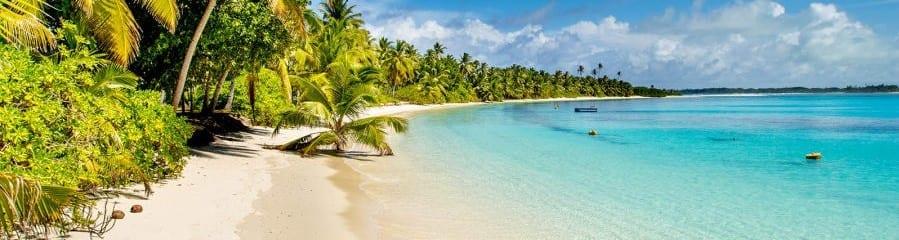 Stunning white sand beach with blue ocean waves