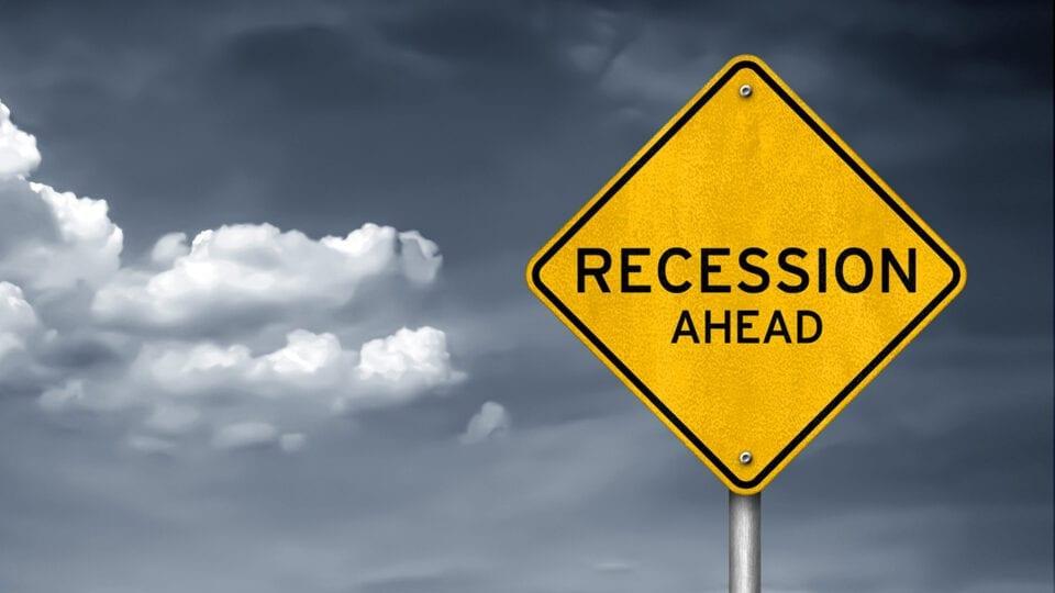 road sign recession ahead