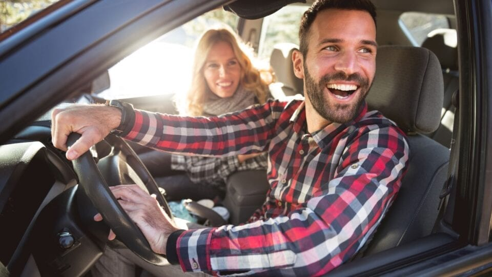 Couple happy knowing they have the Car Insurance they need